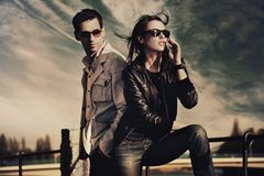 Attractive young couple. Wearing sunglasses