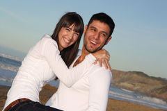Attractive young couple. Attractive young lovers are smiling, laughing and having a good time on a beach Stock Photography