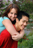 Attractive young couple. Young lovers in a park Royalty Free Stock Image