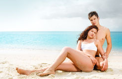 Attractive young couple on the beach Stock Images