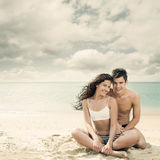 Attractive young couple on the beach Royalty Free Stock Photo