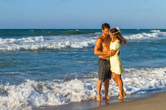 Attractive young couple in beachwear at the beach Royalty Free Stock Photography
