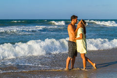 Attractive young couple in beachwear at the beach Royalty Free Stock Images