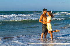 Attractive young couple in beachwear at the beach Stock Photos