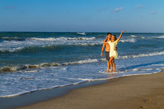 Attractive young couple in beachwear at the beach Stock Photo