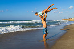 Attractive young couple in bikini and shorts at Royalty Free Stock Image