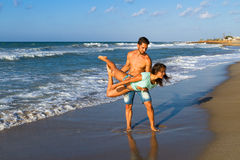 Attractive young couple in bikini and shorts at Stock Photography