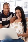 Attractive young couple browsing internet at home Royalty Free Stock Images