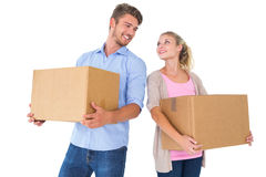 Attractive young couple carrying moving boxes Stock Photos