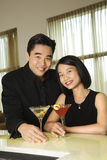 Attractive Young Couple With Cocktails Smiling Stock Image