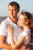 Attractive young couple cuddling at the beach. Close up Stock Image
