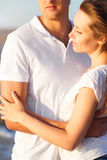 Attractive young couple cuddling at the beach. Close up Stock Photography