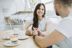 Attractive young couple on a date in a cafe Stock Images