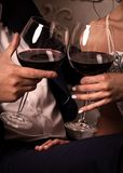 Attractive young couple drinking wine. Closeup happy couple drinking wine Royalty Free Stock Photo