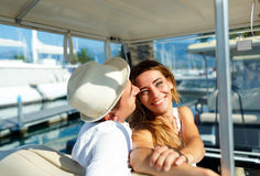 Attractive young couple driving electric car on a luxury waterfront. Attractive young couple driving electric car on the marina on a luxury waterfront royalty free stock image