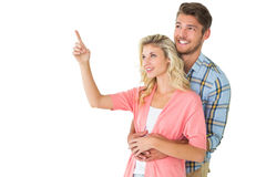 Attractive young couple embracing and looking Royalty Free Stock Images