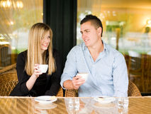 Attractive young couple enjoying beverage. Royalty Free Stock Image