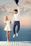 Attractive young couple enjoying the summer date. Attractive and cheerful couple enjoying the summer date Stock Photos