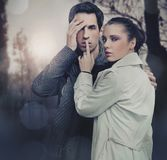 Attractive young couple in the forest royalty free stock images