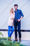 Attractive young couple fronting. In a city environment Royalty Free Stock Photography