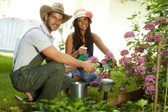 Attractive young couple gardening together Stock Images