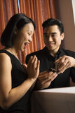 Attractive Young Couple Getting Engaged Stock Photography