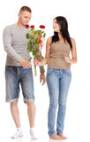 Attractive young couple gift rose in hand isolated Royalty Free Stock Image