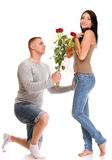 Attractive young couple gift rose in hand isolated Royalty Free Stock Photography