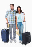 Attractive young couple going on their holidays Stock Photo