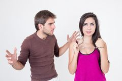 Attractive young couple with handcuffs Stock Photography