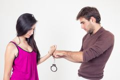 Attractive young couple with handcuffs Royalty Free Stock Photos
