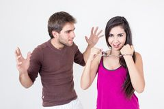 Attractive young couple with handcuffs Stock Image
