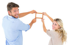 Attractive young couple hanging a frame Royalty Free Stock Images