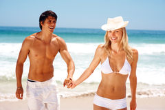 Attractive young couple having fun at the beach Royalty Free Stock Image