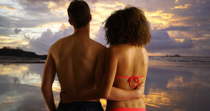 Attractive young couple holding each other on beach. Attractive young couple holding each other on beach Stock Images