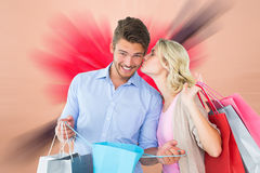 Attractive young couple holding shopping bags Royalty Free Stock Image
