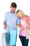 Attractive young couple holding shopping bags Royalty Free Stock Photos
