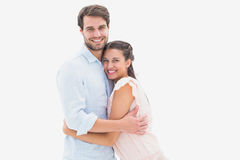 Attractive young couple hugging and smiling at camera. On white background Stock Photos