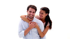 Attractive young couple hugging and smiling at camera