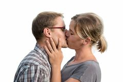 Attractive young couple kissing Stock Images