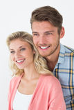 Attractive young couple looking away Stock Image