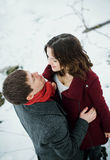 Attractive young couple in love in the snowy Park Royalty Free Stock Images