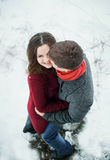Attractive young couple in love in the snowy Park Royalty Free Stock Photos