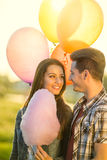 Attractive young couple in love. Soft sunny colors Stock Images