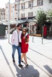 ATTRACTIVE YOUNG COUPLE IN LOVE. Walking in the city on a sunny day Stock Images
