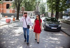 Attractive Young Couple In Love. Walking in the city on a sunny day Royalty Free Stock Photography