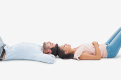 Attractive young couple lying down Stock Images