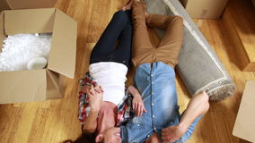 Attractive young couple lying on the floor stock video