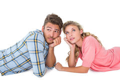 Attractive young couple lying and thinking Royalty Free Stock Photography