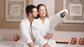 Attractive young couple makes a selfie in Spa Center. Attractive young couple makes a selfie in Spa Center stock video footage